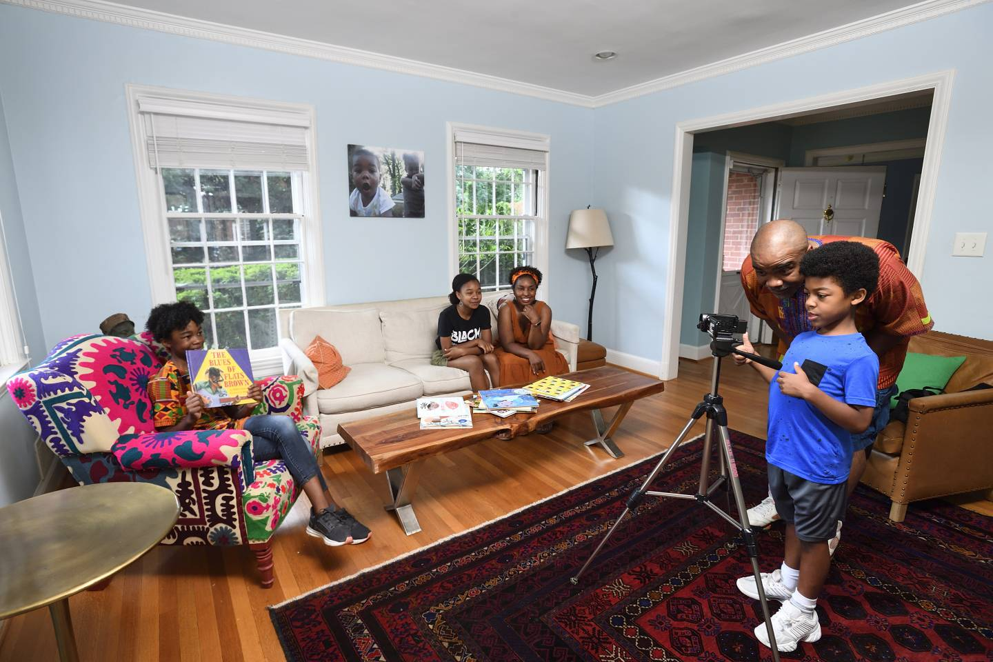 A family records a video in their living room