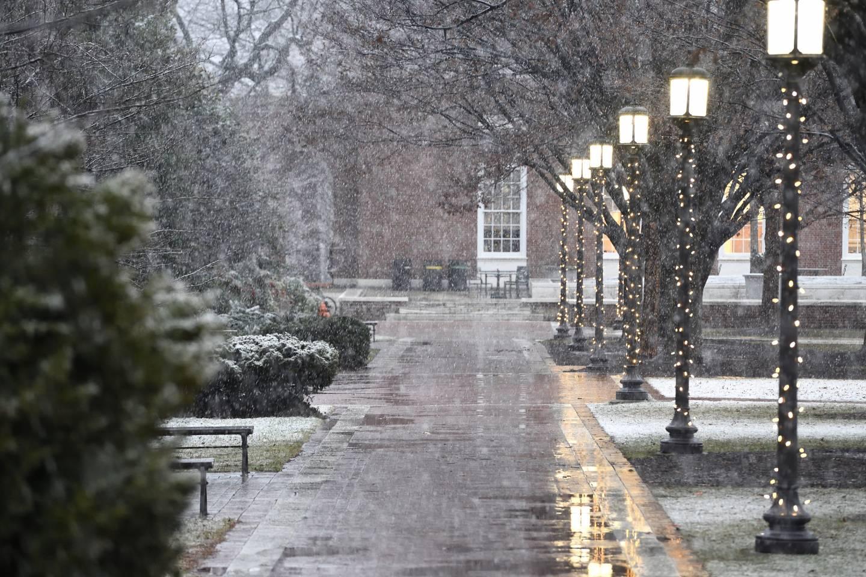A light snow falls on Homewood campus