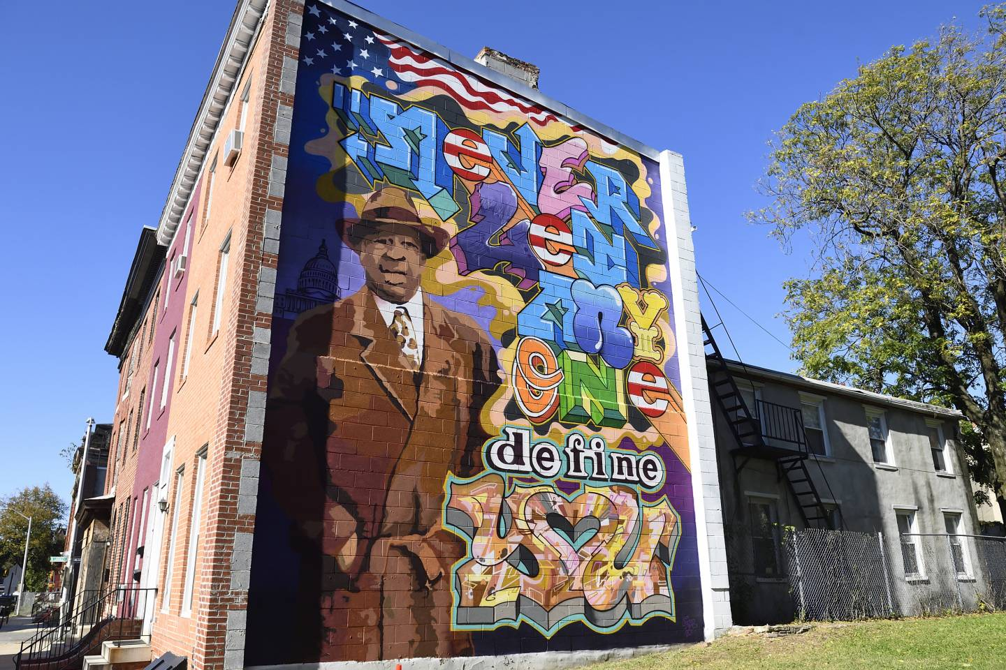 Mural on the side of a row home depicts U.S. Rep. Elijah E. Cummings