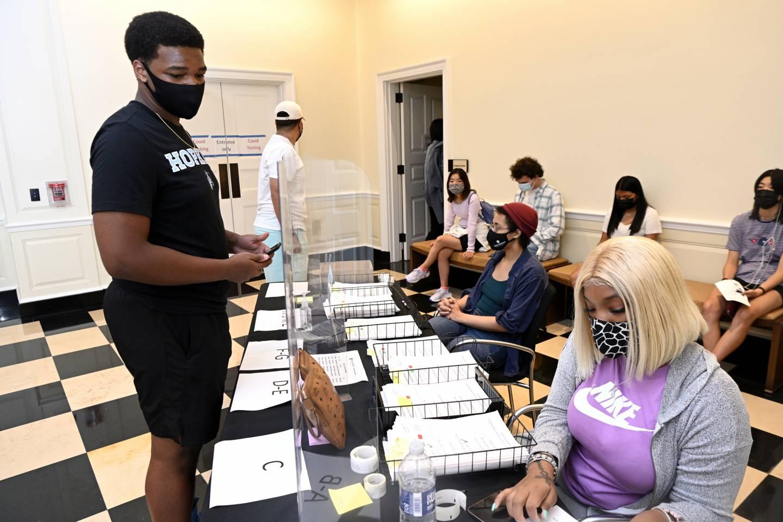 A student checks in during mandatory coronavirus testing