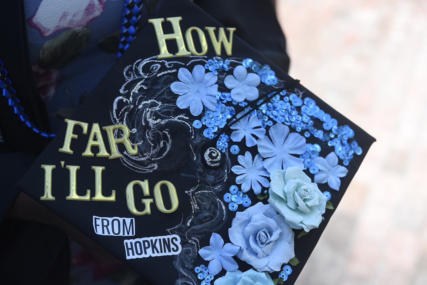 A decorated mortarboard with blue jewels