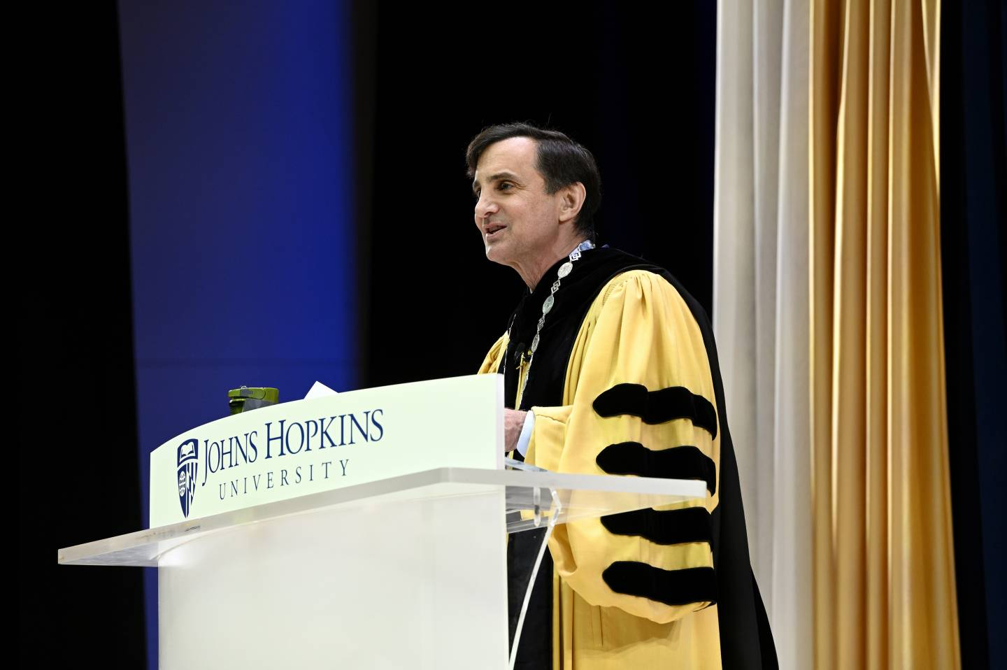 JHU President Daniels wears his customary Commencement regalia to give an address