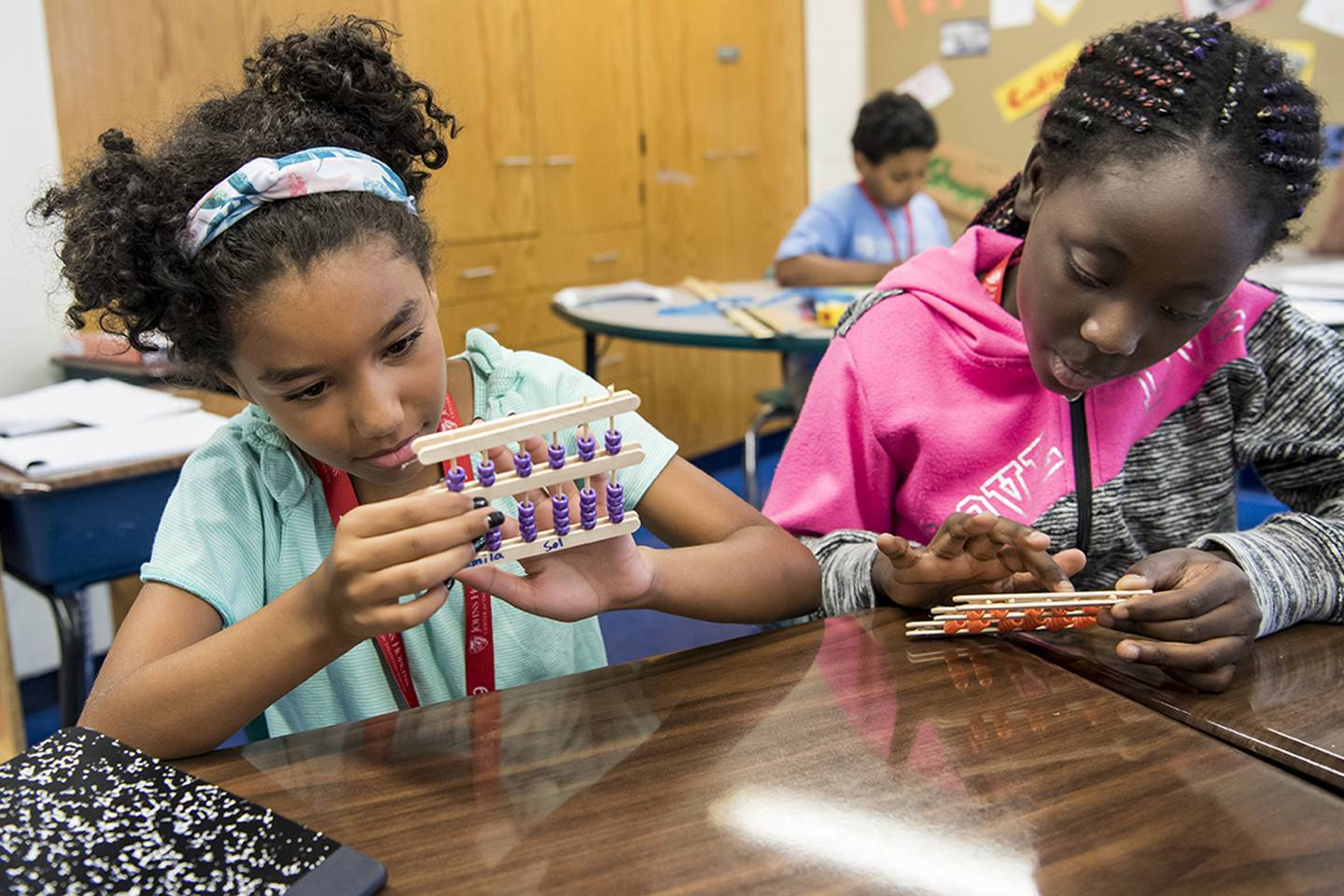 Students make an abacus during their Number Sense class at the CTY Baltimore Emerging Scholars Summer Program at Commodore John Rodgers Elementary/Middle School.