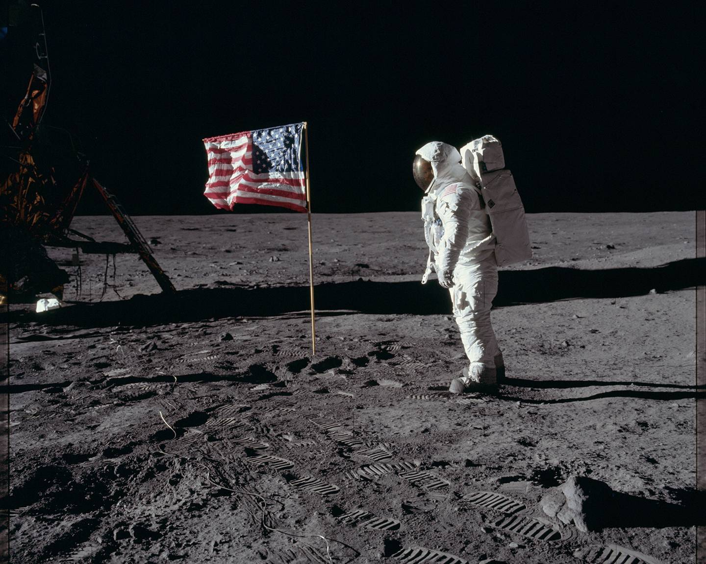 Buzz Aldrin salutes the American flag on the moon