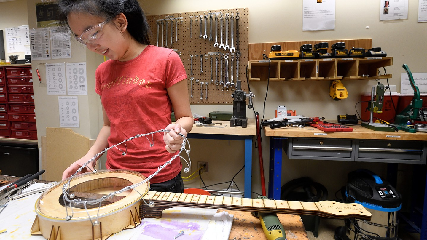 A student builds her banjo