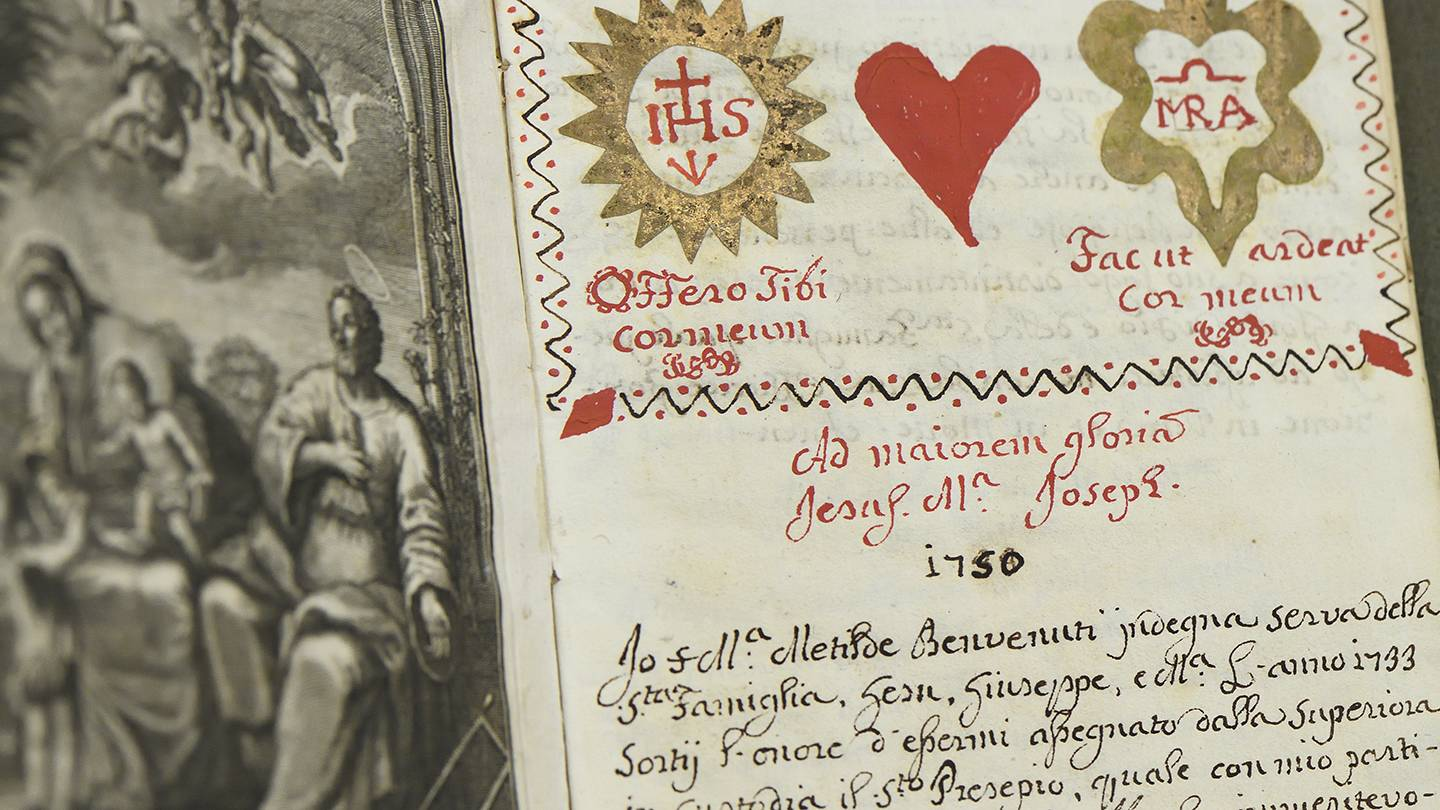 Title page of handwritten journal includes red and gold ink