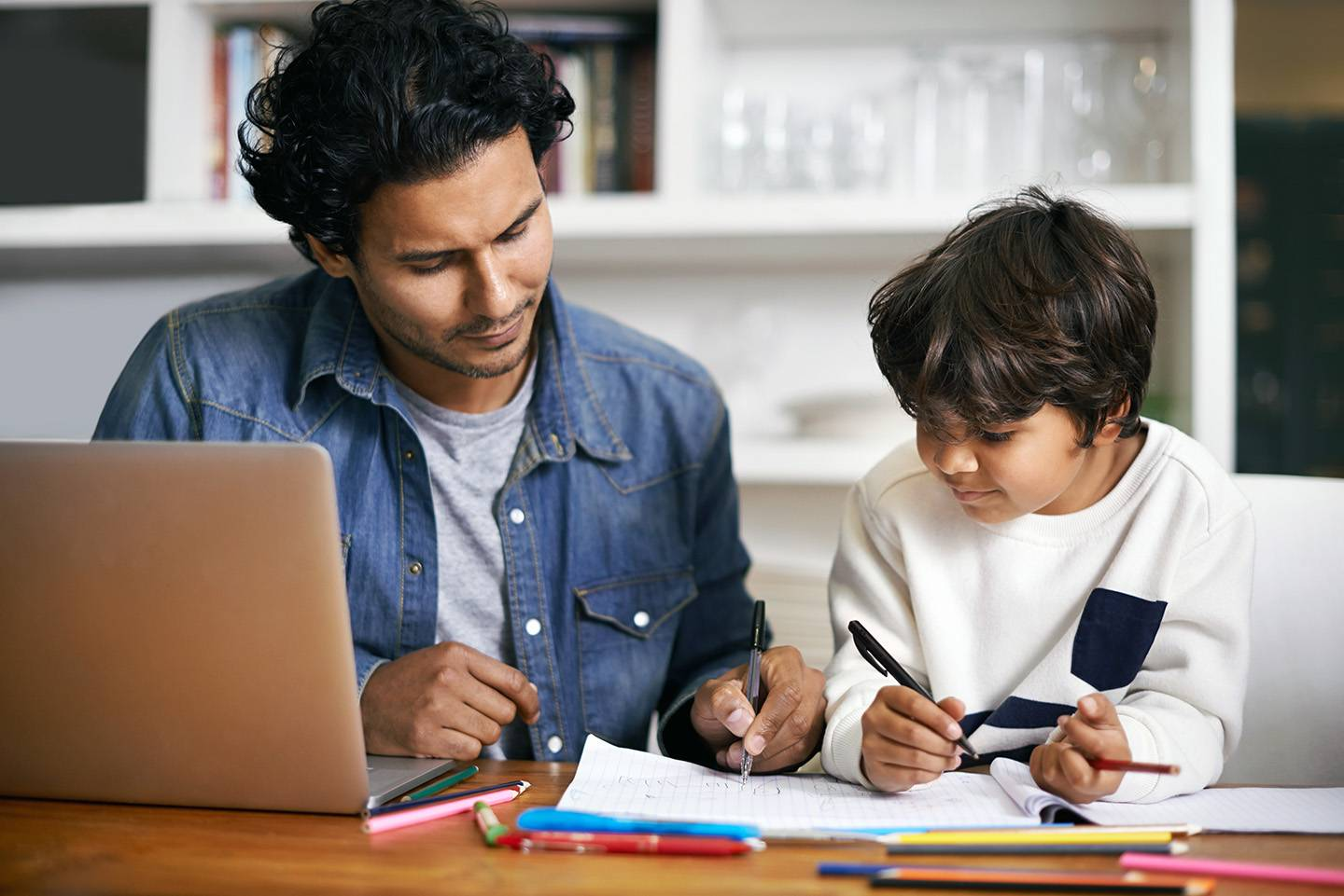 Father and son studying together