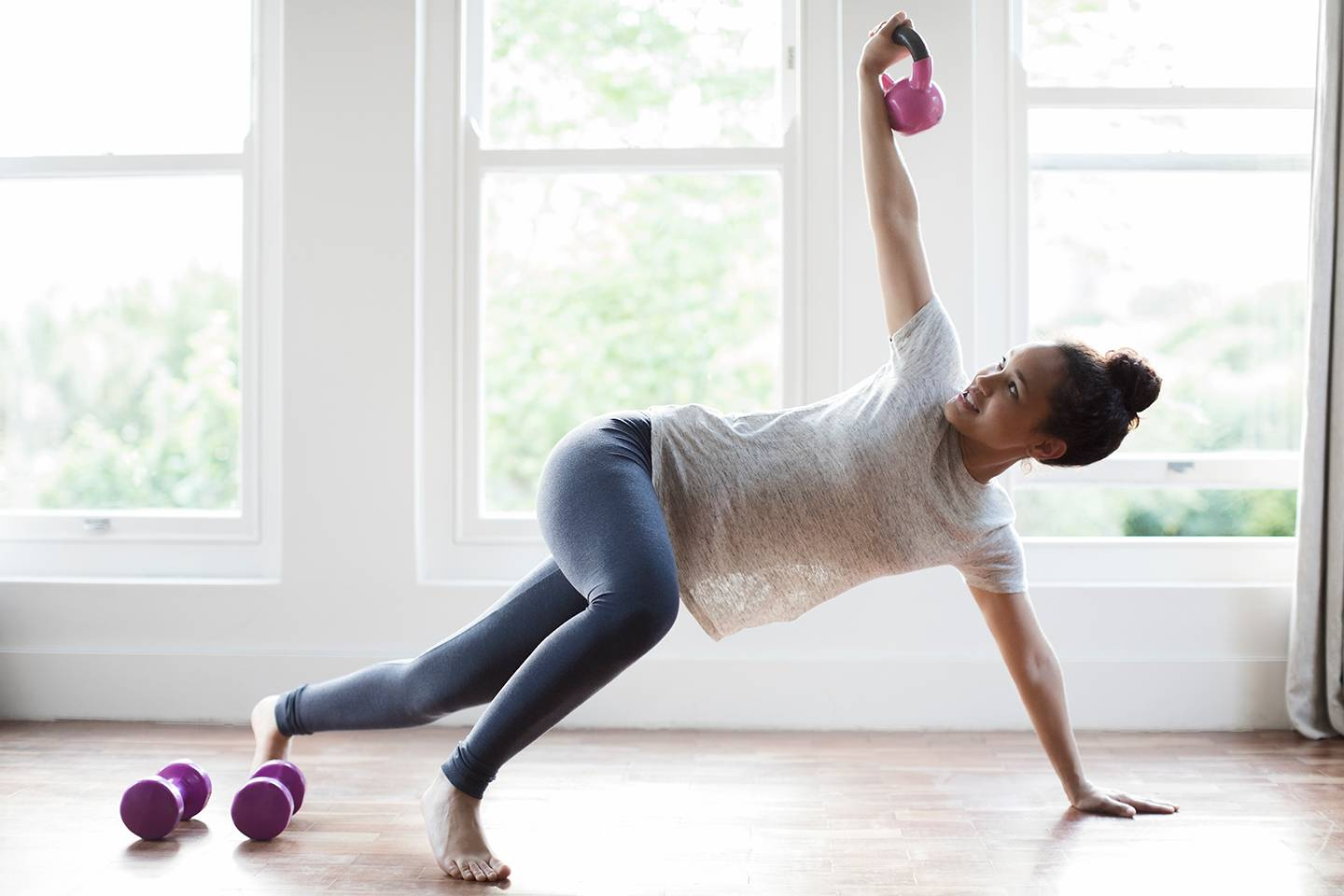 Woman working out with kettleballs
