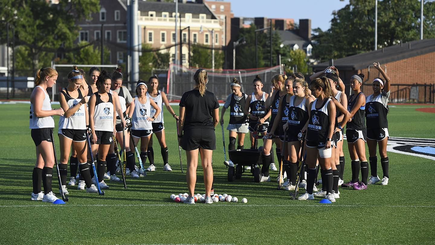 The field hockey team practices