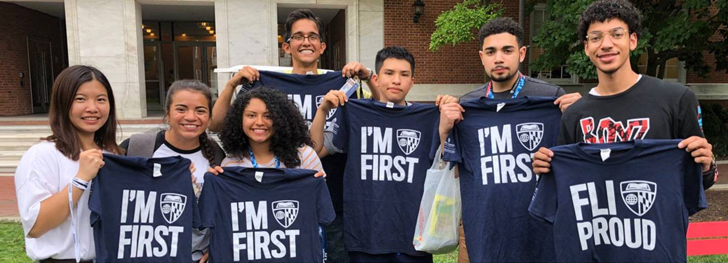 Student pose with I'm First t-shirts