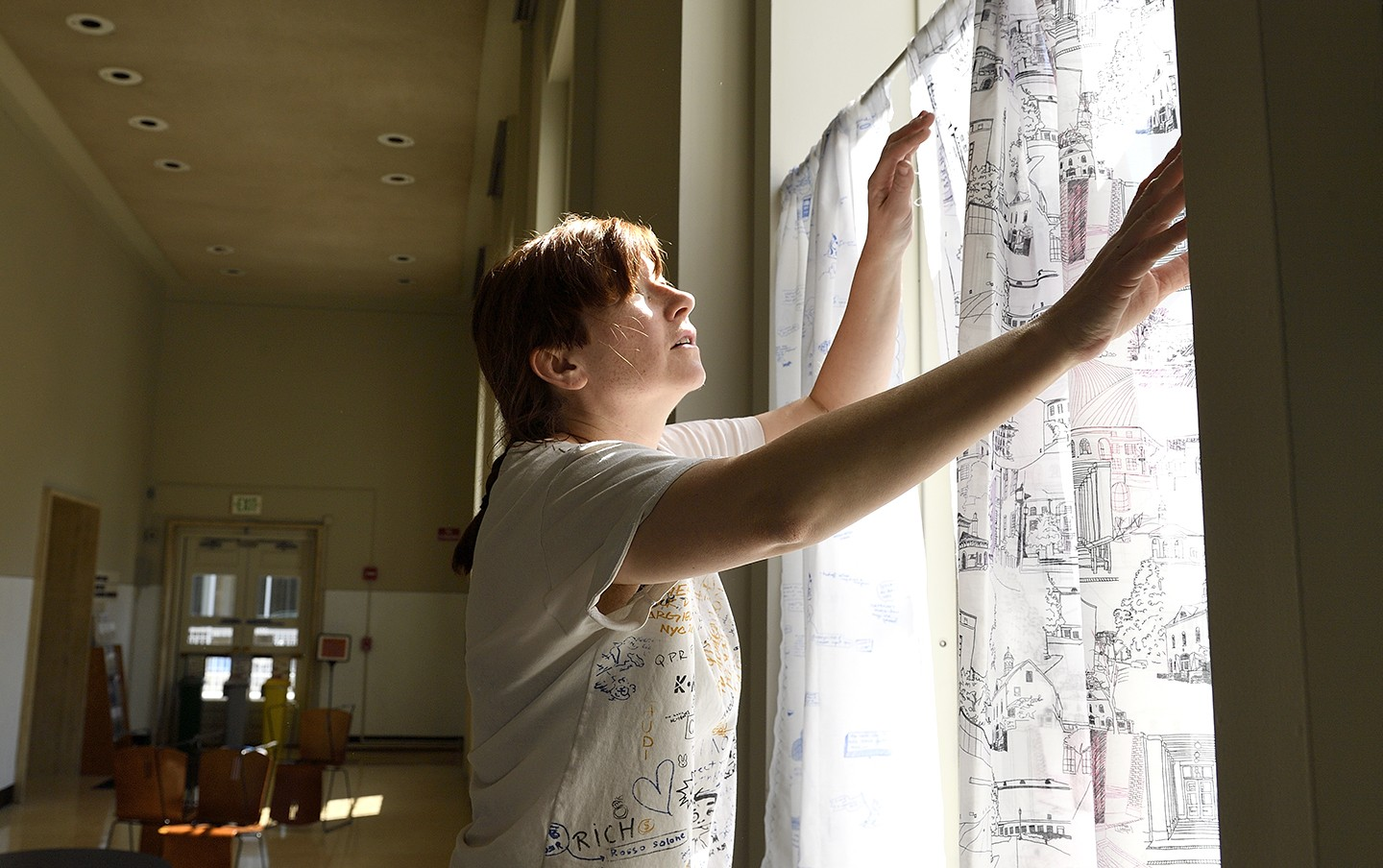 Artist hangs hand-drawn curtains