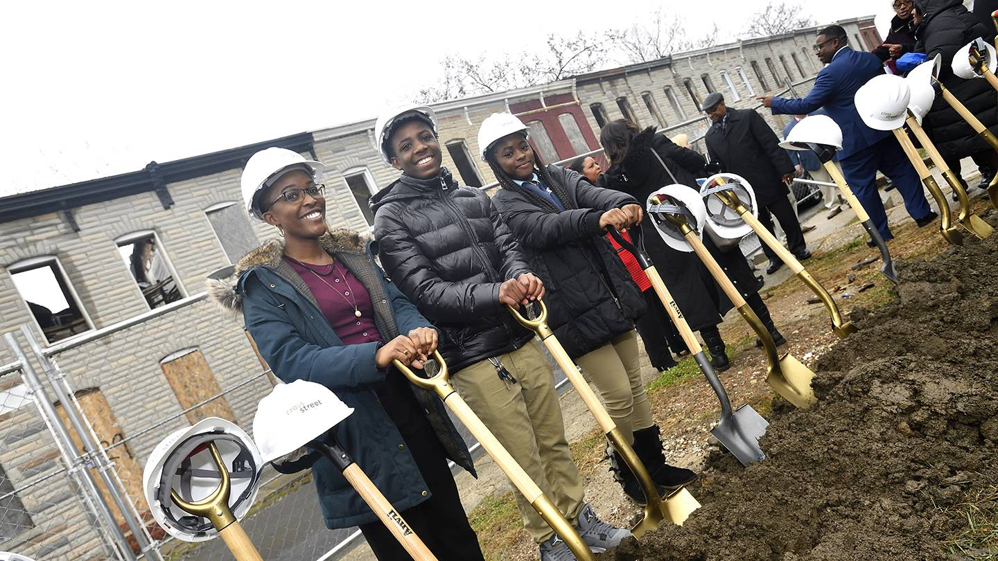 Photo of students holding shovels
