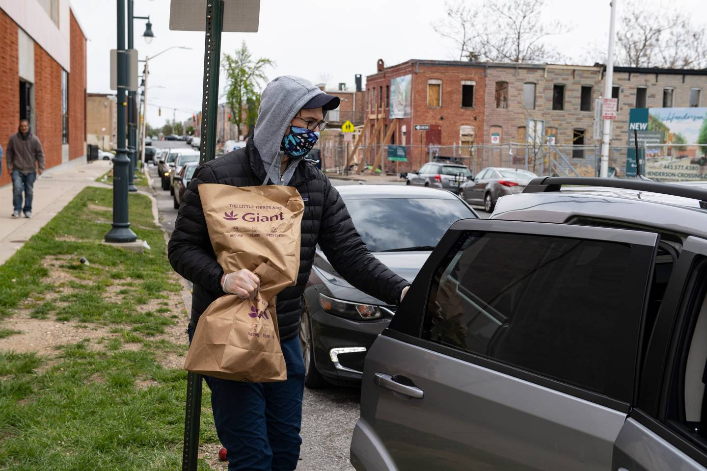 A man loads food into his car