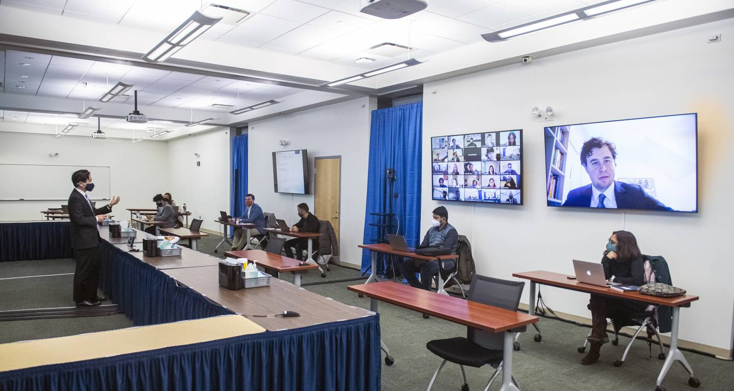 A hybrid virtual and in-person lecture is held at the Carey Business School