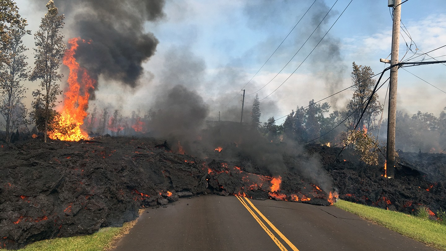 Lava overtakes a road