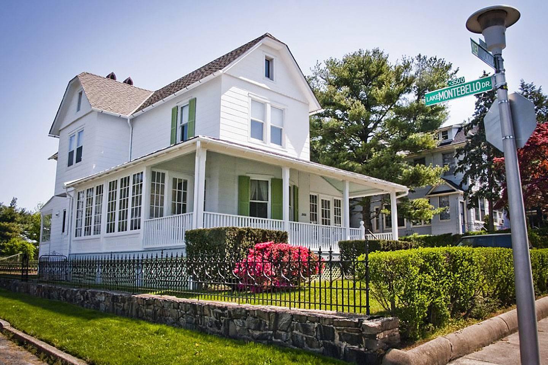 White clapboard house in Mayfield neighborhood