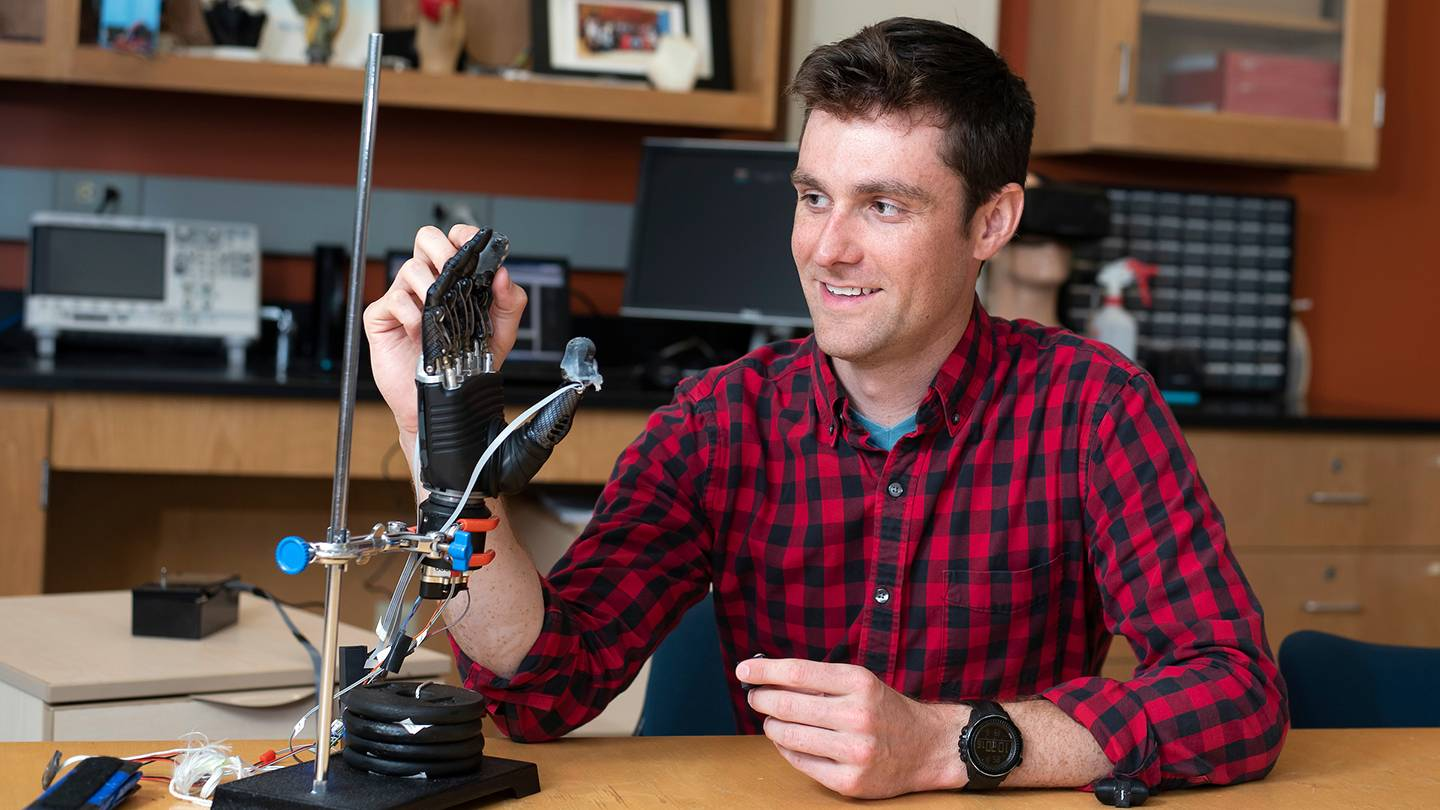 Luke Osborn interacts with prosthetic hand