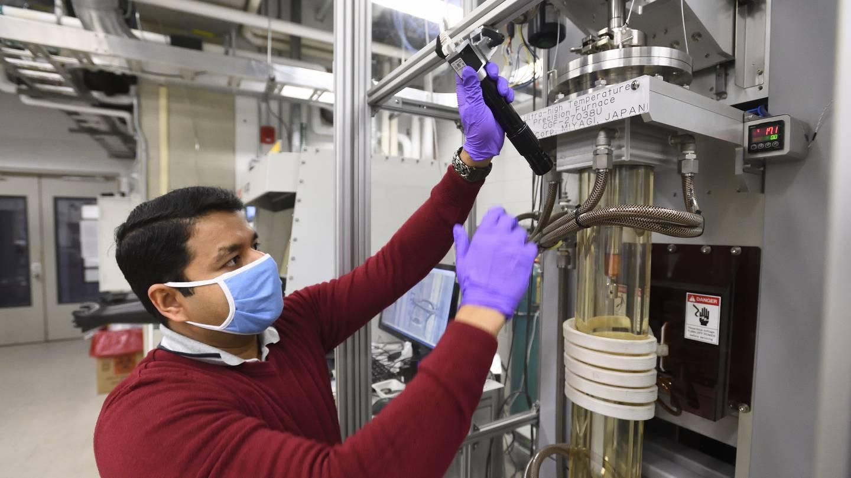 Bulk crystal scientist Mojammel Khan loads a furnace in the PARADIM lab