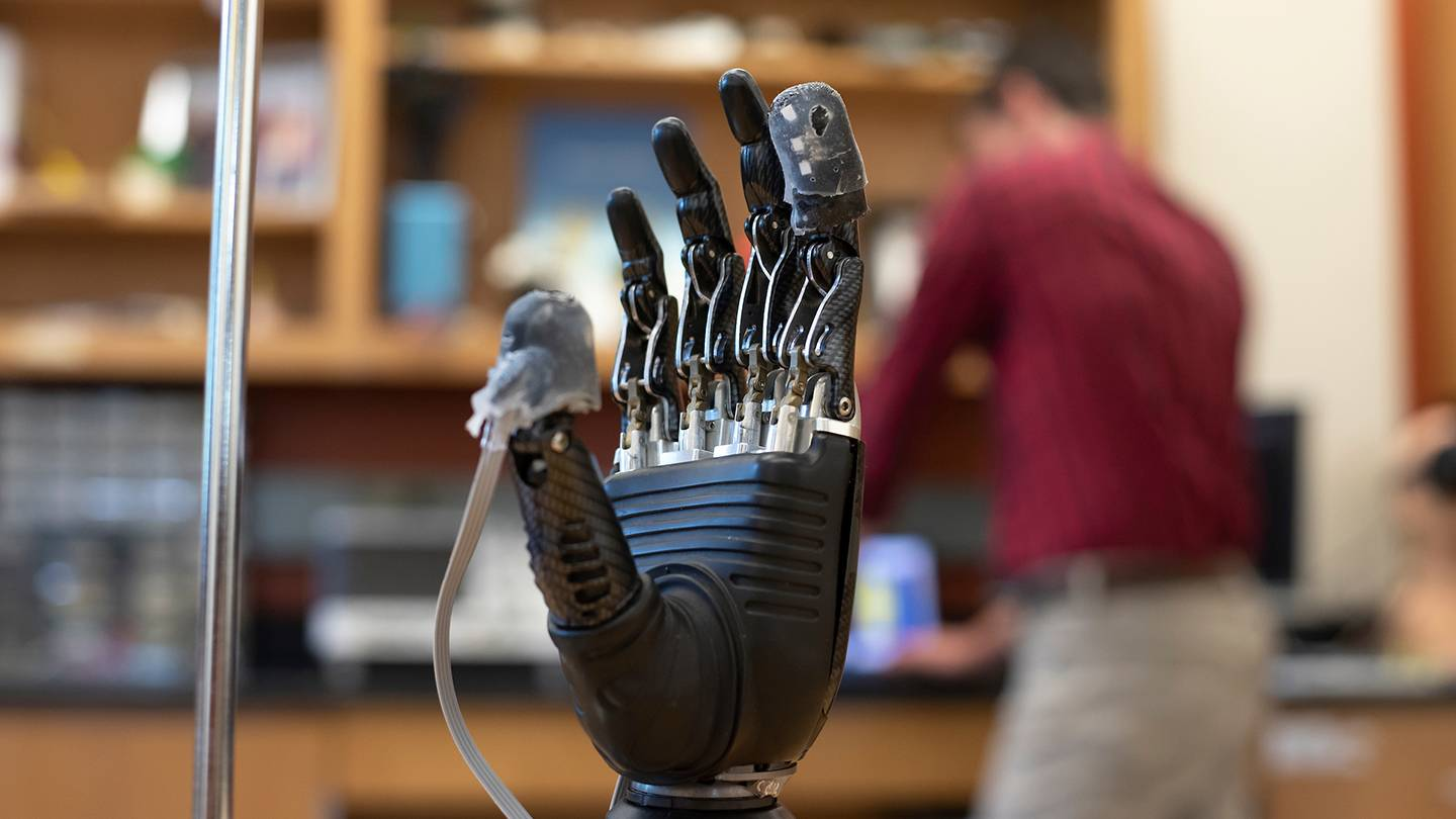 Close-up of prosthetic hand with sensory sleeve on fingertips