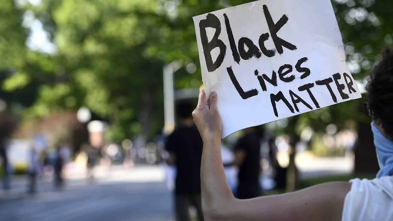 Person holds up 'Black Lives Matter' sign