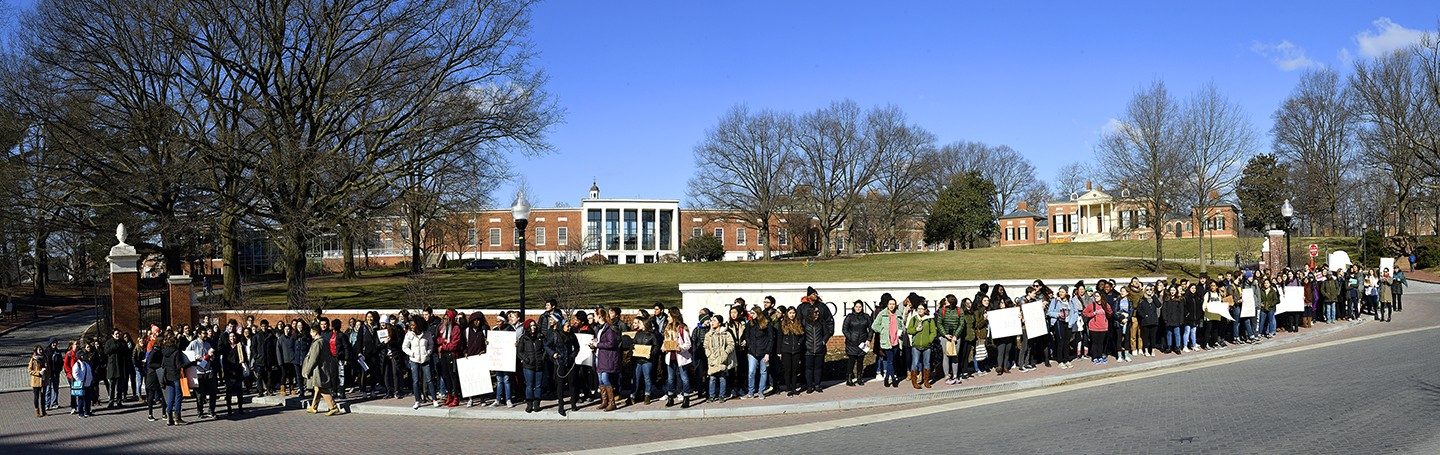 Student protesters line Charles Street in front of the Johns Hopkins University campus
