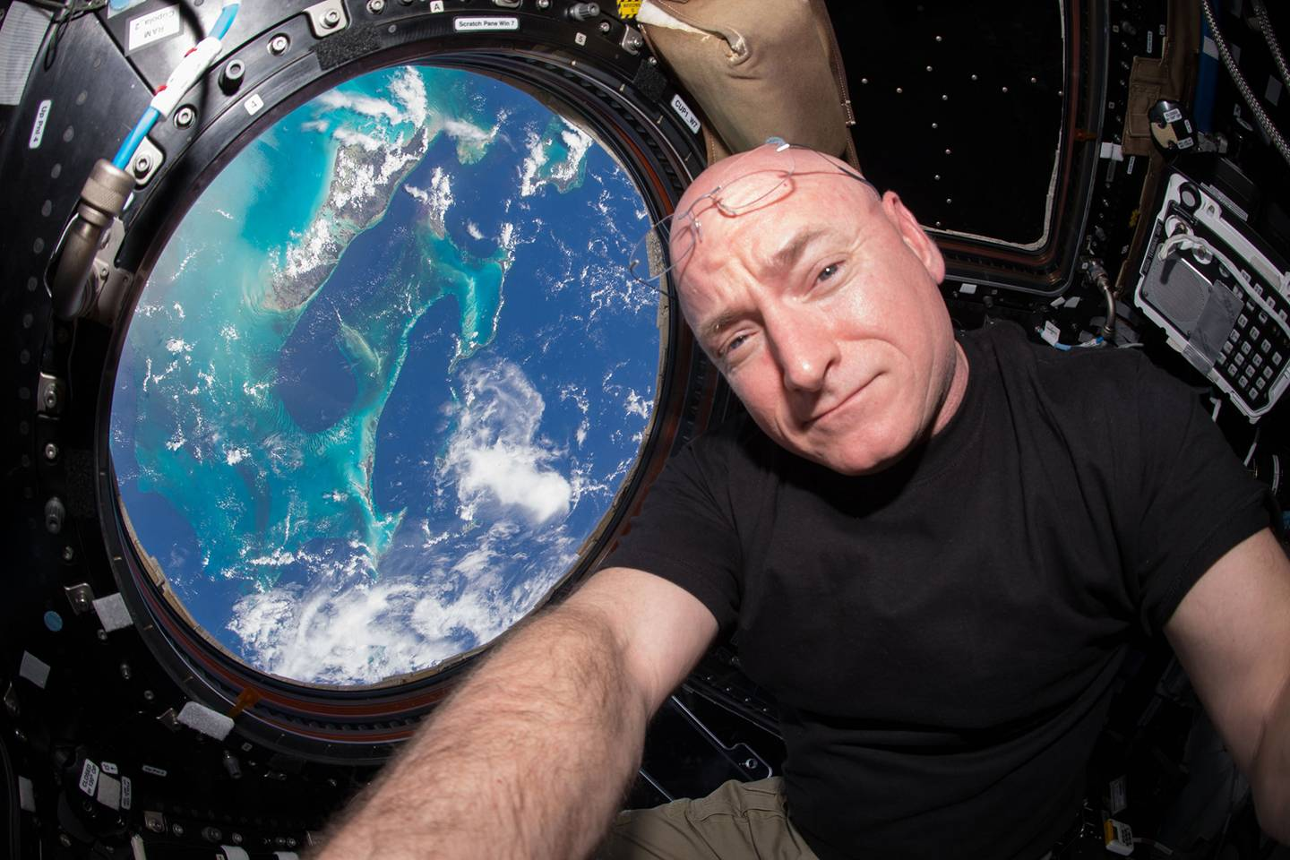 Scott Kelly looks out at Earth from the International Space Station