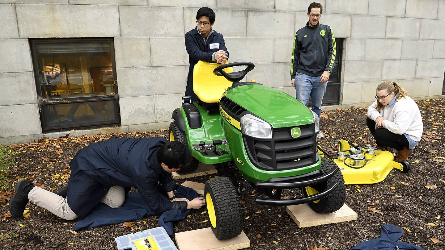 Students work on a tractor