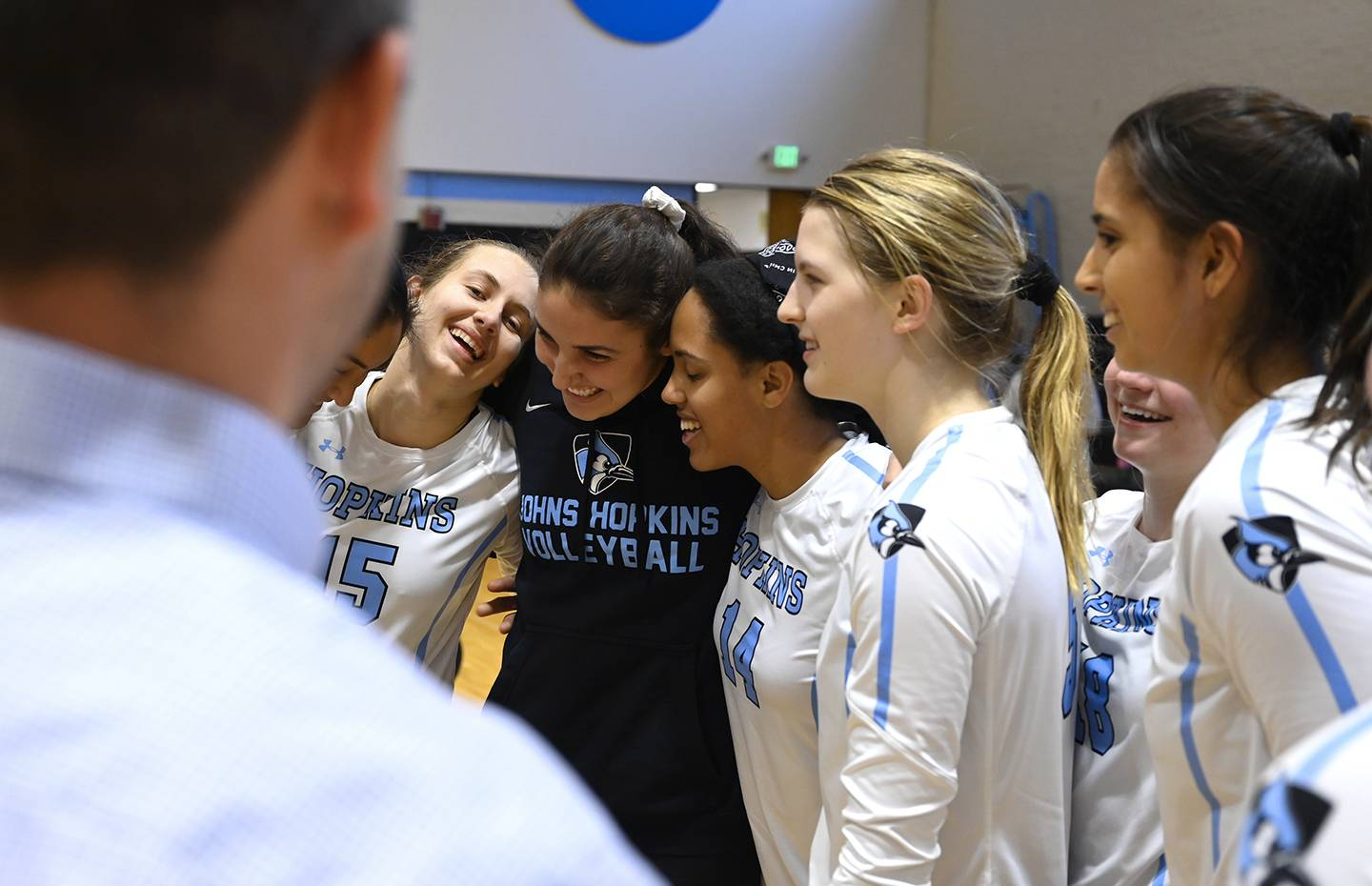 Hopkins volleyball players huddle