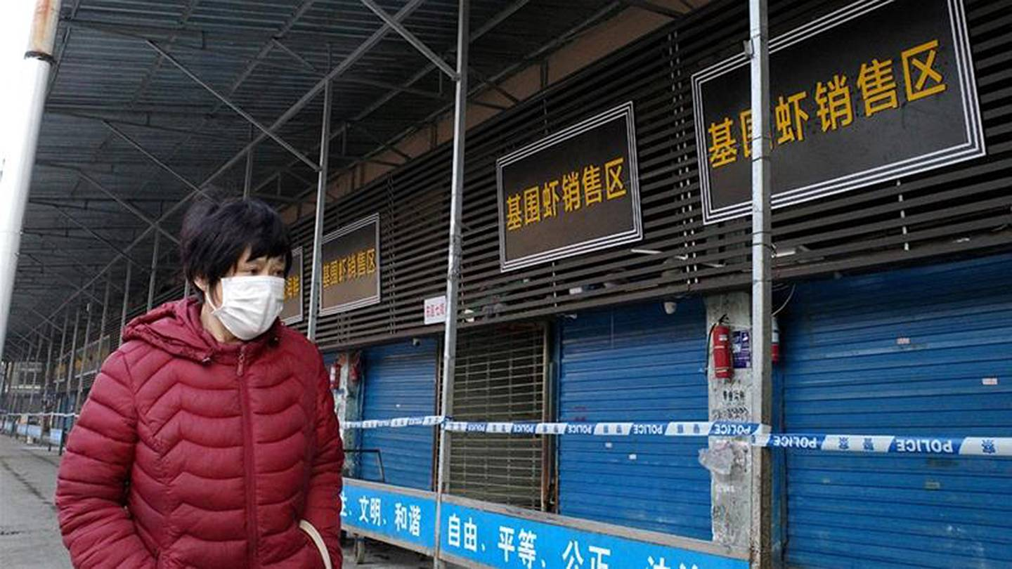 A woman wears a face mask to protect from diseases such as coronavirus