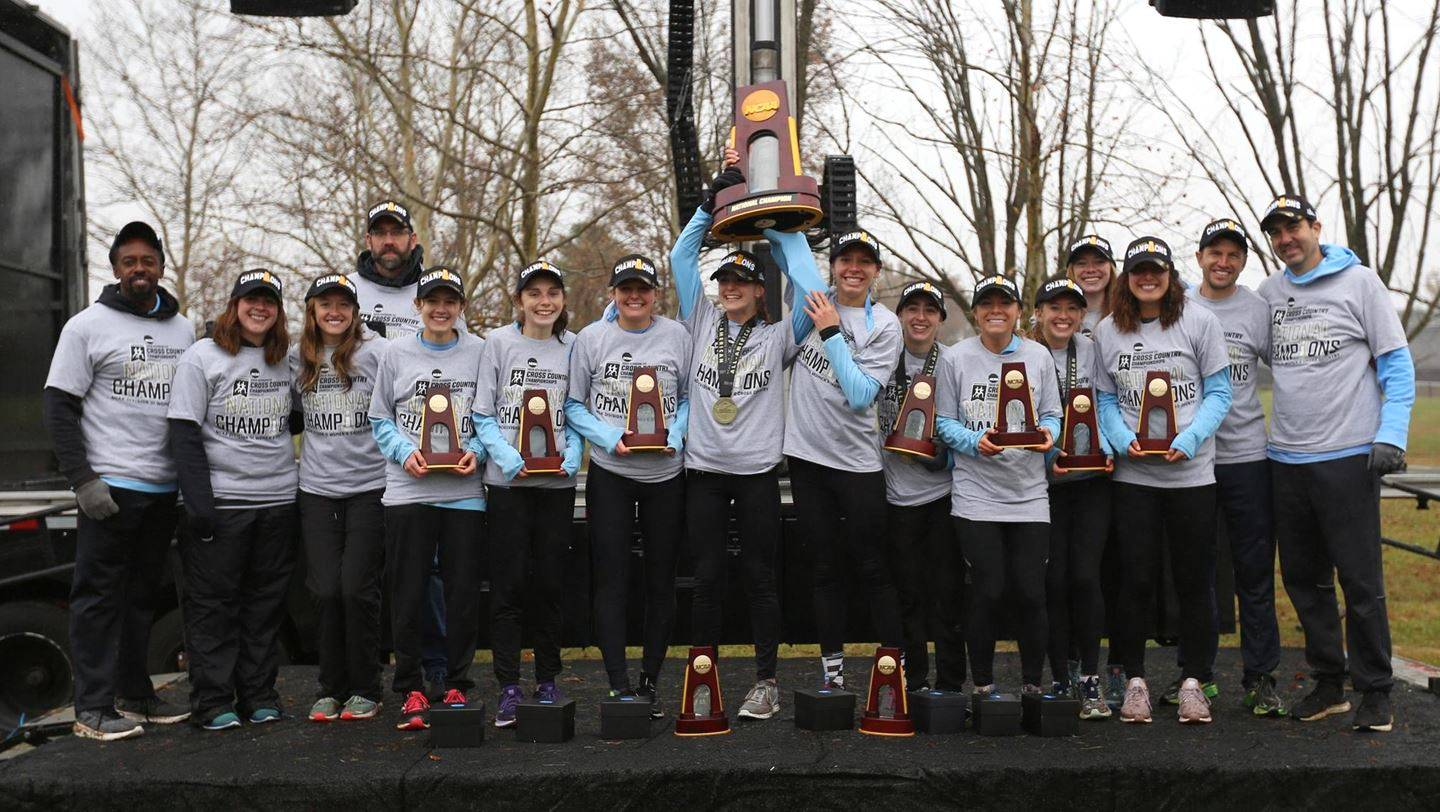Johns Hopkins women's cross country team with NCAA championship trophy
