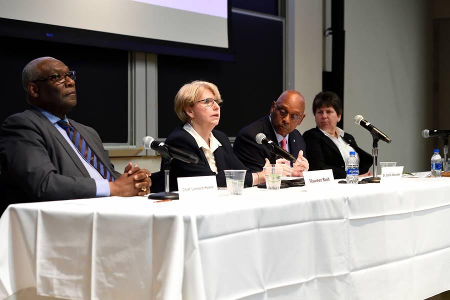Four people speak on a panel