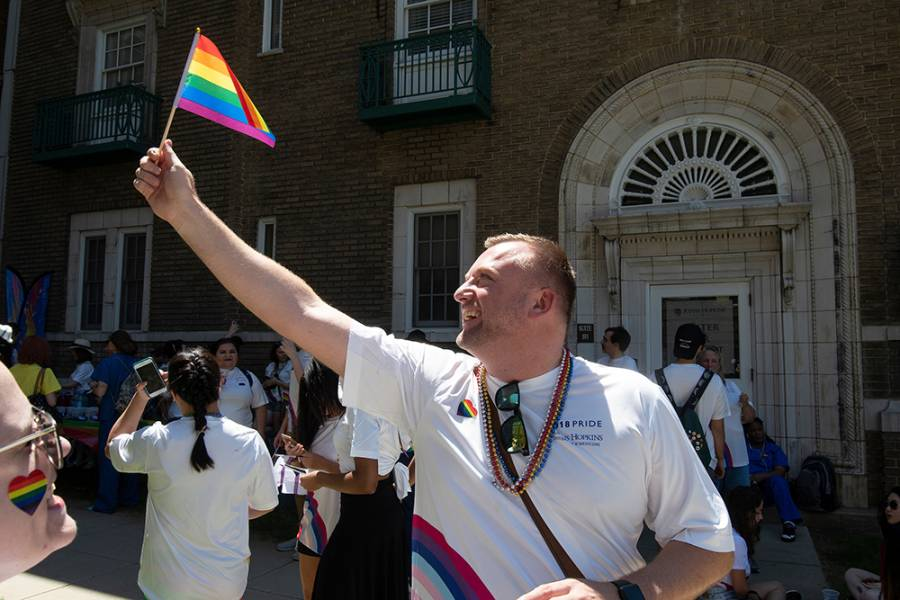 Man waves gay pride flag