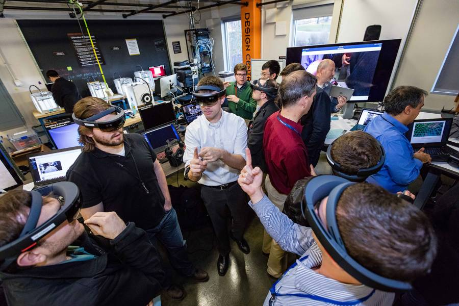 Group of people wearing VR goggles