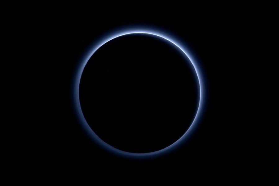 Blue haze surrounds Pluto