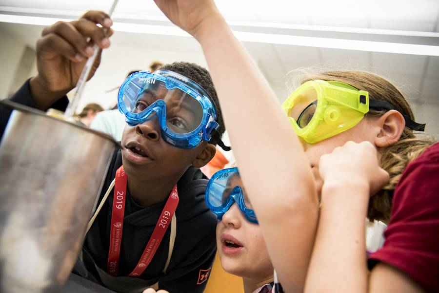 Students learn to measure calorie amounts in food while participating in a chemistry lab at CTY's Baltimore site at Gilman School this summer.