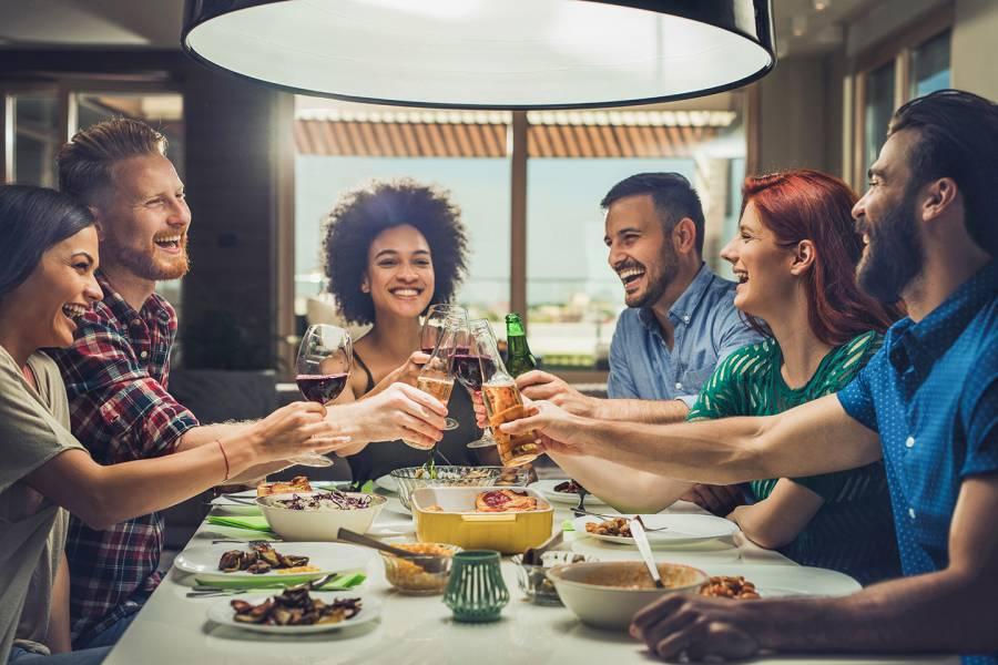 Groups eating dinner together