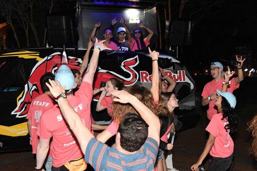 Students dance while a DJ spins