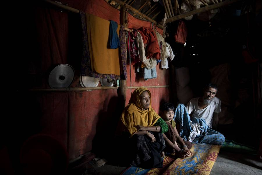 A Rohingya family in their home in the Kutupalong Rohingya Refugee Camp in Bangladesh