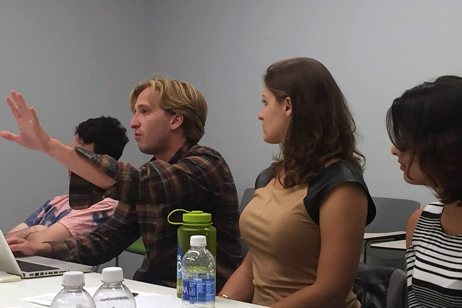 Students talk in a seminar room