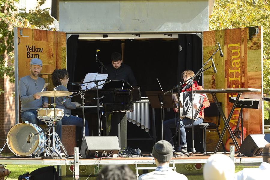 Musicians play on Yellow Barn Music Haul stage: Ian Rosenbaum on vibraphone, Carla Kihlstedt on piano, Merima Kluco on accordion, Matthias Bossi on drums