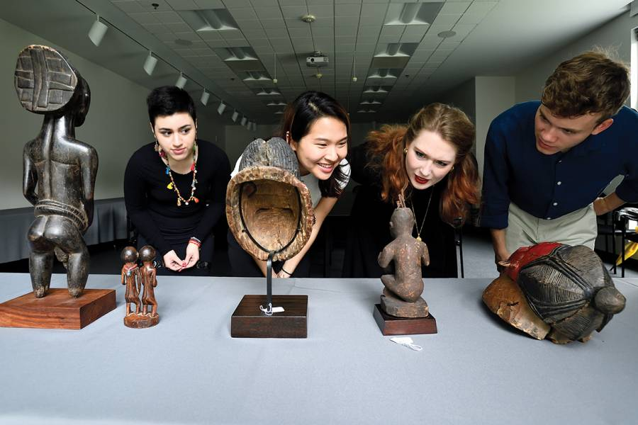 Students examine African artifacts