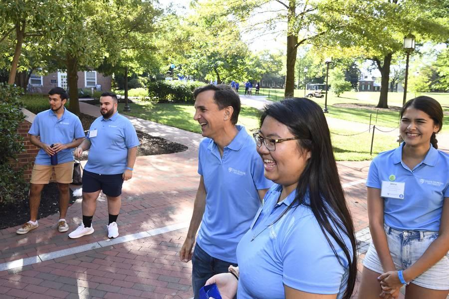 JHU President Ronald J. Daniels helps greet new students