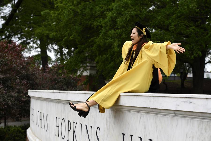 Student wears Commencement regalia