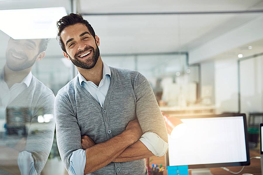 Happy looking man in office setting