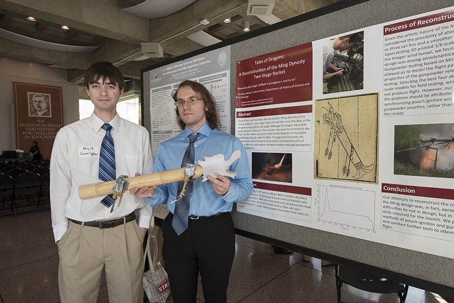 Streit Cunningham (left) and Alex De La Vega present their rocket prototype