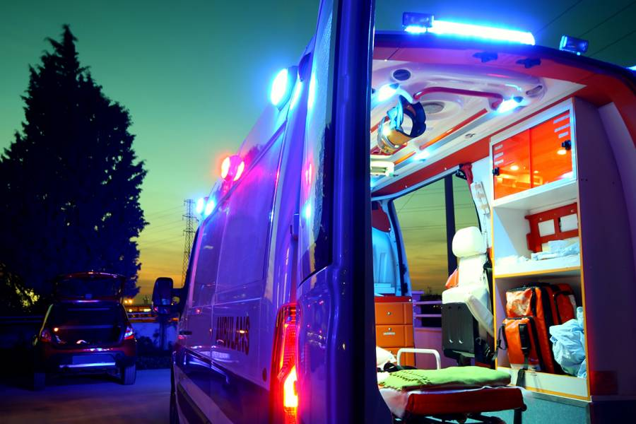 An ambulance stands open in the early hours of the morning