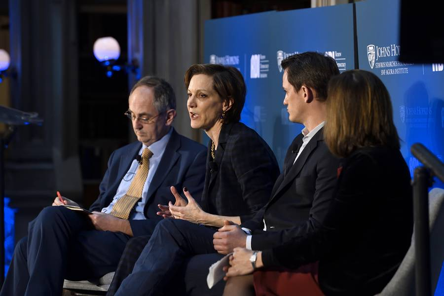 Anne Applebaum moderates a panel discussion with three other experts