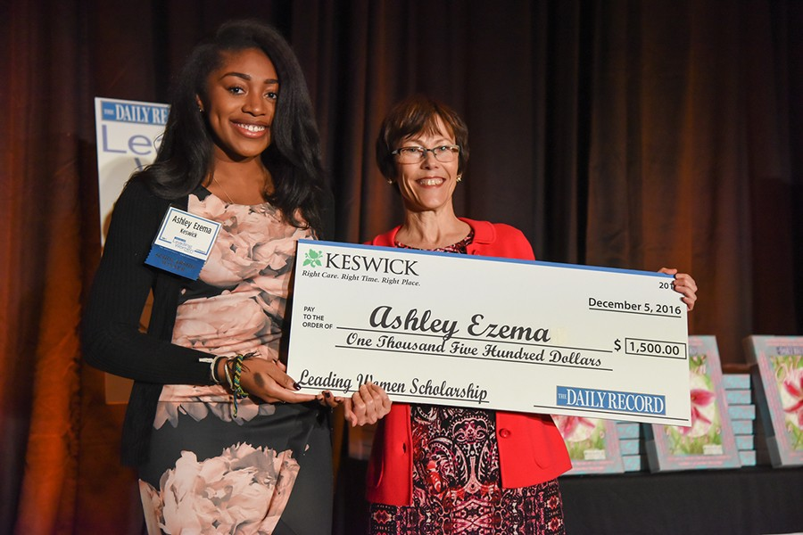 Ashley Ezema receives $1500 novelty check as scholarship recipient