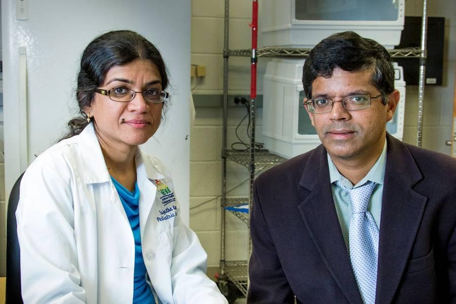 Johns Hopkins researchers Sujatha Kannan and Kannan Rangaramanujam sitting in a lab