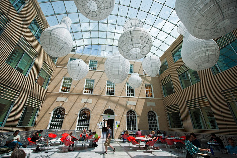 Large white paper lanterns hang over atrium space